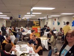Friday: More of the main game room. That's Vickie Watson (BGGMom) in the lower right corner. 