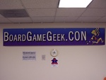 Friday: We're here! The BGG.CON banner in the entry/welcome area.